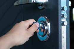 Open door of a family home. Close-up of the lock with your keys on an armored door. Security. Key cylinder, close up photo. The door lock with keys in situation it is closed.