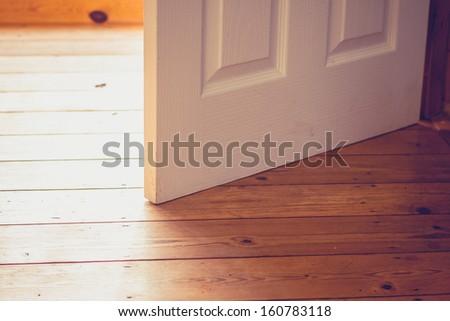 Open door on sunny day