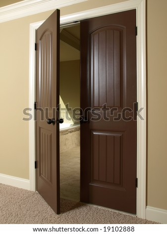 Open Double Dark Wood Door to Bathroom