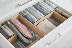 Open drawer with different textiles in kitchen, above view