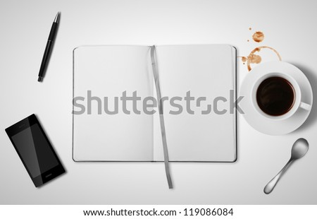 open empty book and cup of coffee
