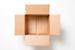 Open empty rectangular cardboard box on white background. Mockup for design and advertising. Brown craft paper or carton box mock up. Top view