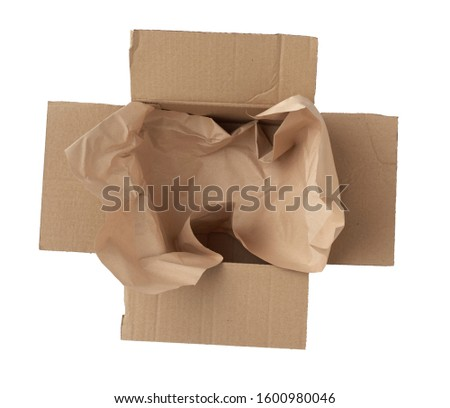 open empty square brown cardboard box for transportation and packaging of goods isolated on white background, top view. Template with square brown cardboard box