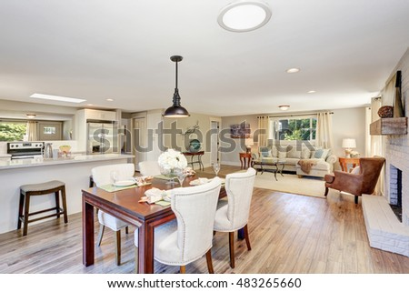 Open floor plan dining area with elegant table setting and white soft chairs. Northwest, USA