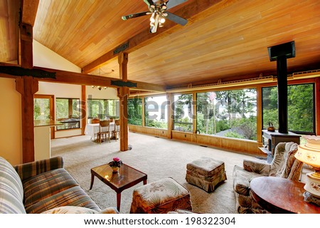 Open floor plan in log cabin house. View of living room and  dining area #198322304