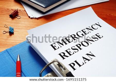 Open folder with Emergency response plan. Stock foto ©
