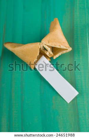 Open fortune cookie with message about love