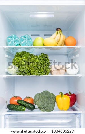 Open fridge full of fresh fruits and vegetables, healthy food background, organic nutrition, health care, dieting concept #1334806229
