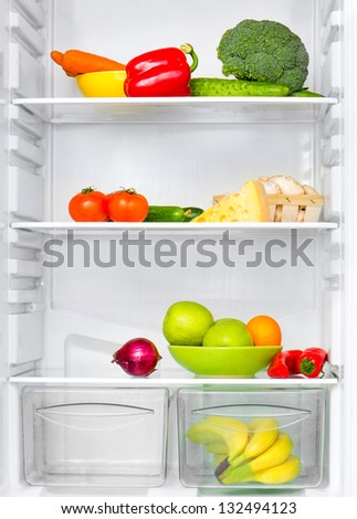 open fridge with fresh vegetables