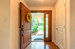 Open front door with wreath interior view