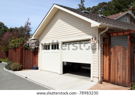 Open garage door in suburban house