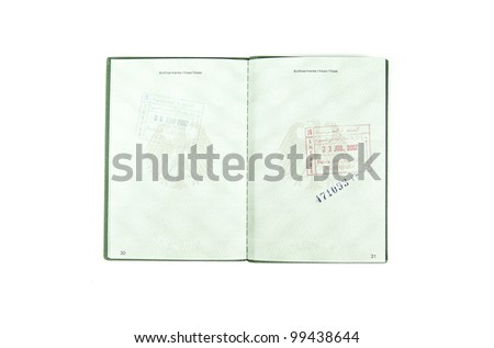Open german passport  to two pages with some customs stamps on a white background