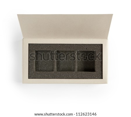 Open gift box. A box with lid open, with inner foam cushion separated in  three sections. Isolated on white.