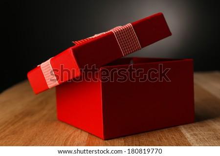 Open gift box on dark background