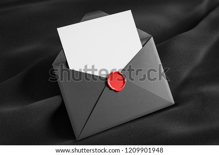 Open gray envelope with blank sheet of paper and red stamp lying on black tissue. Communication concept. 3d rendering mock up stock photo