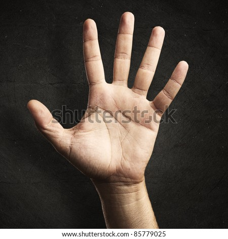 open hand against a grunge background
