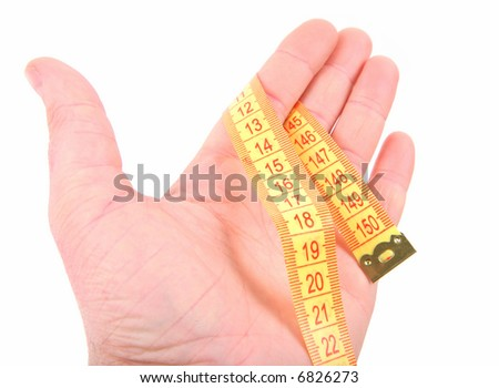 Open hand with curled yellow measuring tape on white background