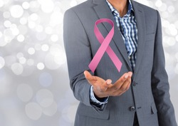Open hand with pink ribbon for breast cancer awareness
