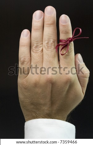open hand with red ribbon, don't forget