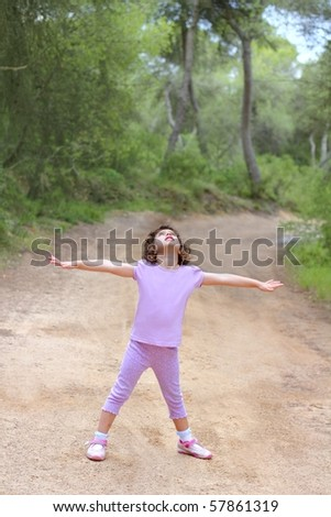 open hands happy little girl forest truck pine woods park - stock photo