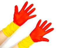 Open hands in rubber gloves on white background. Red yellow rubber glove for everyday household chores. Female cleaning concept. Erasing from whiteboard clipart. Woman on housekeeping. Washing gloves