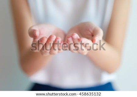 open hands of woman sign of begging,giving,holding with blurry background on her