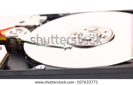 Open harddisk isolated on white background closeup of hard disk drive