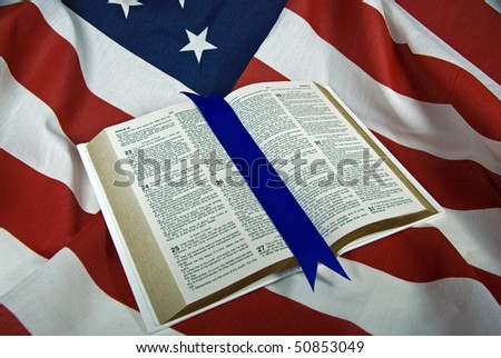 open holy bible on flag - stock photo