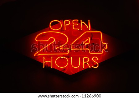 Open 24 Hours neon sign on a restaurant