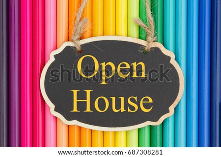 Open House text on a chalkboard with colorful pencil crayons #687308281
