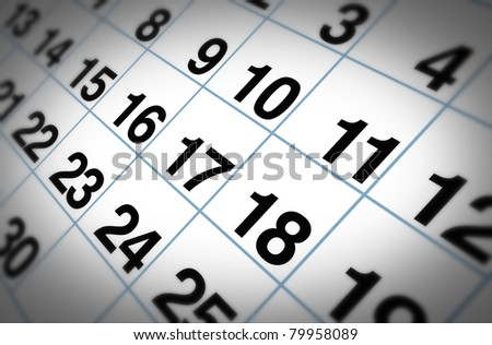 Open important date on a daily month calendar representing planning and strategy for family and business events.