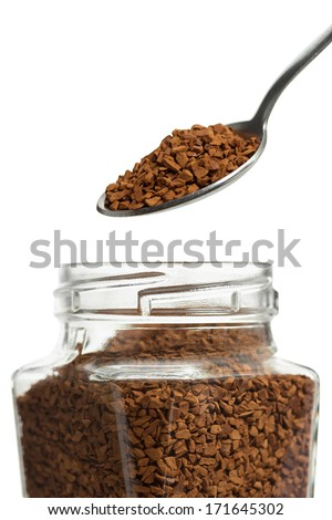 Open jar with instant coffee and a spoon