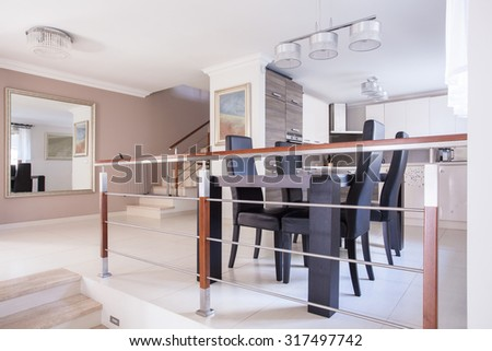 Open kitchen and dining area in modern residence