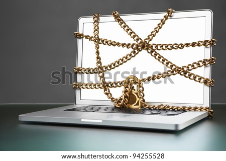 Open laptop, blank white screen and surrounded by locked chain
