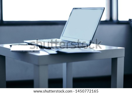 open laptop digital tablet and work documents on the Desk #1450772165