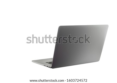 Open laptop notebook isolated on white background. Thin, modern looking. Copy space for text or image. Metallic silver color. Work from home or work from anywhere concept.