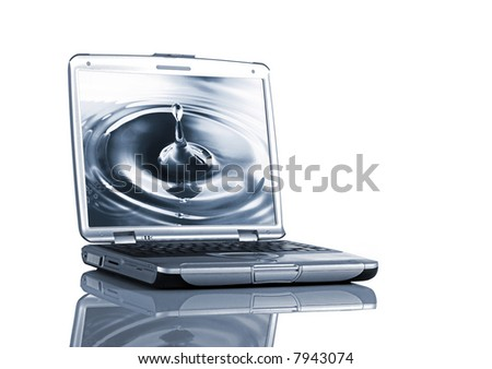Open Laptop on a desk with relfection with a image of a waterdrop on the display