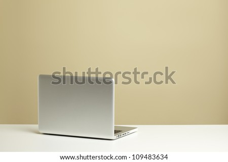 Open Laptop on white desk