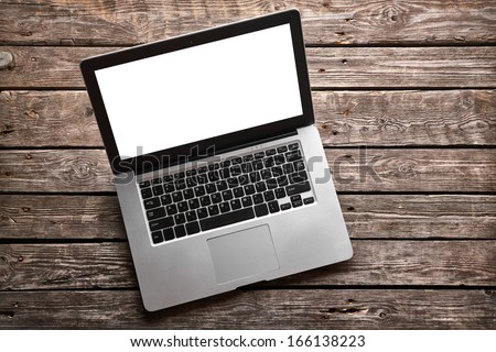 Open laptop with isolated screen on old wooden desk. #166138223