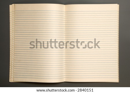 Open lined notebook isolated over grey background