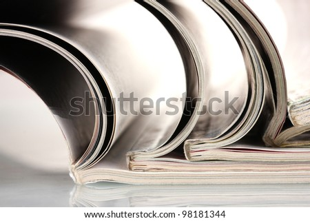 open magazines isolated on white