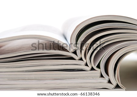 Open magazines on white background