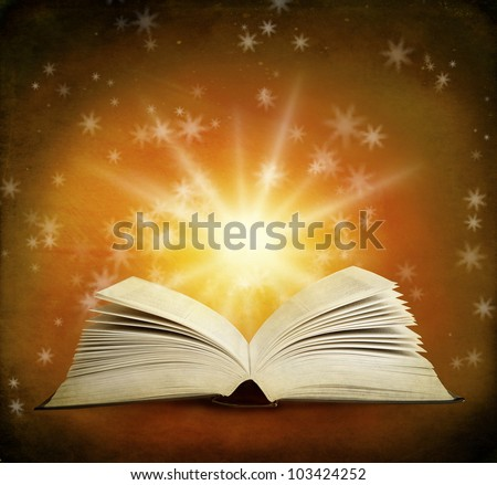 Open magic book on a background and lights