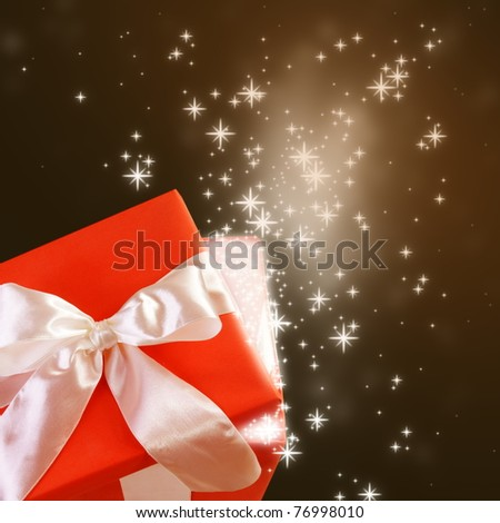 Open Magic Gift Box with Glittering Sparkles - stock photo