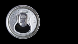 Open metal aluminum can for carbonated drinks, beer, energy drinks and mineral water on a black background. Water drops on an aluminum can. Refreshing drink. A drink with gases.