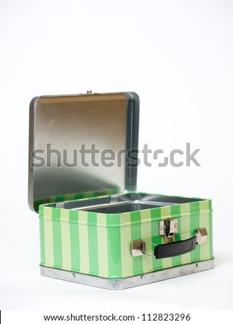 Open metal lunch box over white