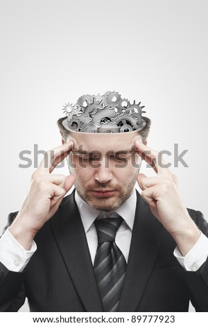 Open minded man with gears and cogs inside showing brain activity. Conceptual image of a open minded man