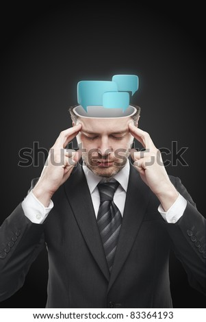 Open minded man with speech bubbles inside. Conceptual image of a open minded man. Isolated on a black background