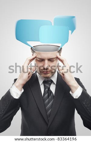 Open minded man with speech bubbles inside. Conceptual image of a open minded man. Isolated on a gray background
