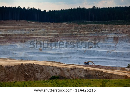 Open mine pit excavating glass sand